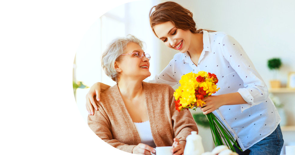 caregiver holding flowers for her patient