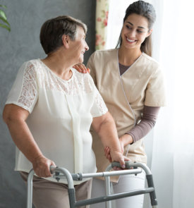 caregiver helping her patient in walking