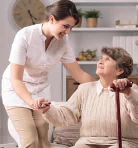 caregiver assisting her patient