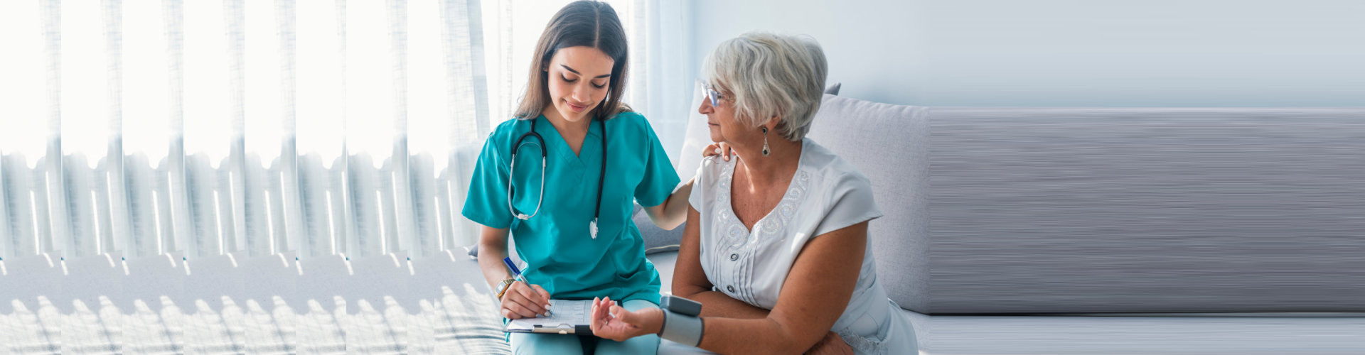 caregiver doing blood pressure monitoring to senior woman
