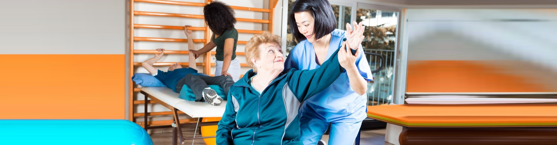 senior man and woman assisting with their caregiver doing regular exercise